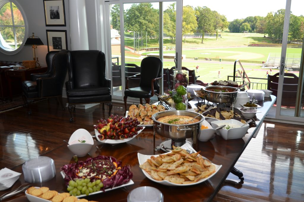 the football stadium lounge set up with a buffet of catered food